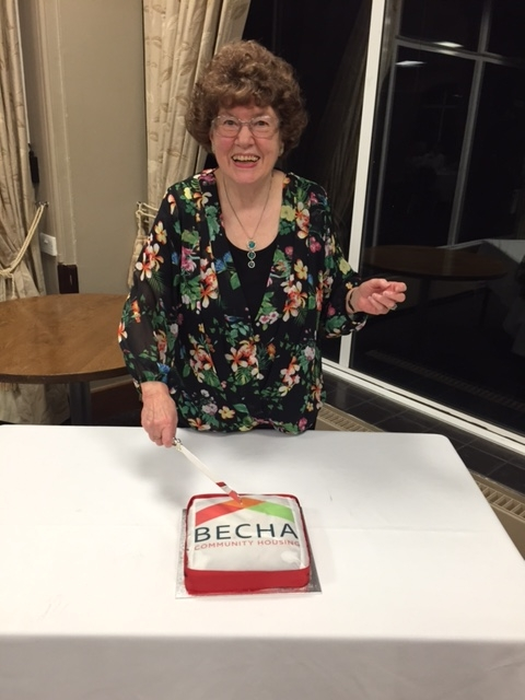 Brenda Reid, our co-founder, cutting the cake at BECHA's 50th anniversary celebrations. In other photos, residents, staff and contractors, Leigh Pattison, BECHA's vice-chair says goodbye to Grant Blowers, stepping down after many years service to the board, and Sue Daniels, our Chief Executive.